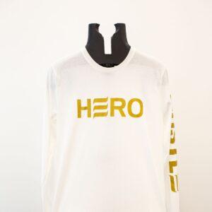 Gold logo on white long sleeve shirt